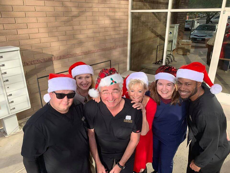 Dr. Kammeyer and staff celebrating the holidays at Solutions Dental Implants